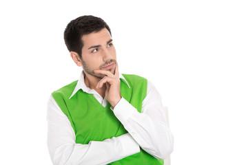 Junger nachdenklicher Business Mann in Grün isoliert auf Weiß