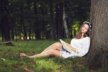 Woman sleeping peacefully in the forest