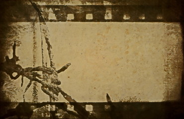 concept old grunge film strip and barbed wire