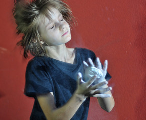 child with a ball of powder magnesia chalk