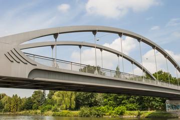 Bridge under cloudy sky