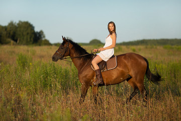 Girl in white dress on a horse
