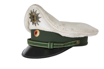Police hat, against  of the German police officer