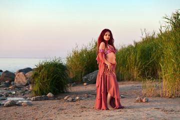girl in east dress on seacoast