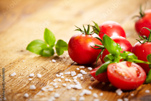 Fotobehang Groenten Tomatoes lying on old table. Diet food