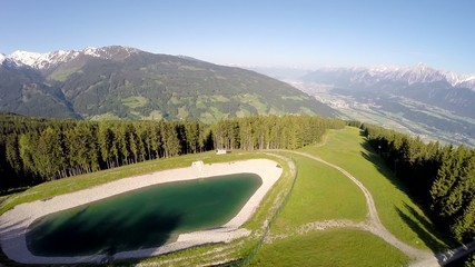 Panorama Flight over a Mountain Lake - Aerial Flight