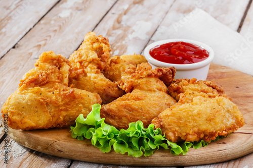 Foto op Canvas Vlees fried chicken wings in batter