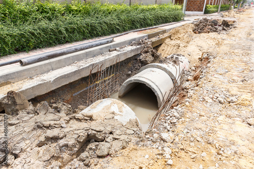 Sewer installation in city - 68601787