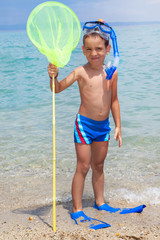 happy child with diving equipment on the beach