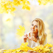 canvas print picture - Woman laying in autumn park