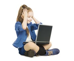 Schoolgirl child looking at computer. school girl with notebook