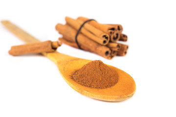 Milled cinnamon on wooden spoon
