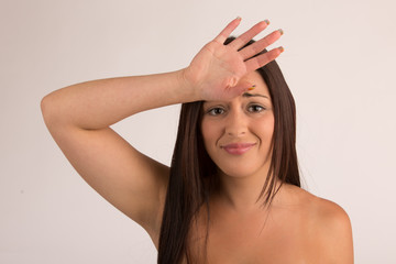 Woman with hand on forehead very upset sad disappointed depress