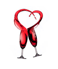 Heart splash from two glasses of red wine isolated on white back