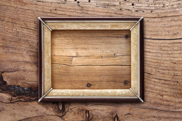 Old frame on a wooden background