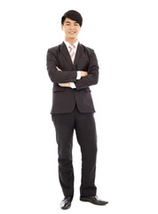 young businessman standing and across hands
