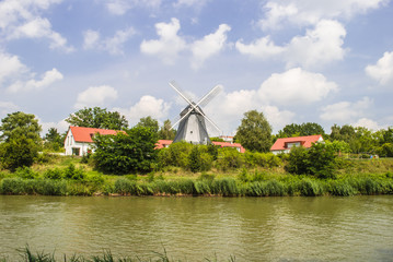 Traditional Windmill by the River