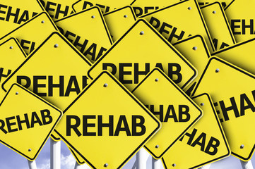 Rehab written on multiple road sign