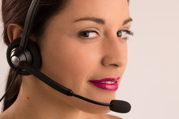 Call center customer service agent. Woman with headset smiling