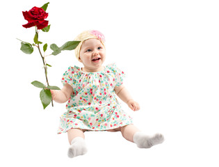 Little cute child girl with flower isolated on white