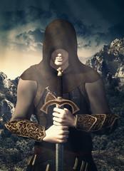 cavaliere con cappuccio e spada
