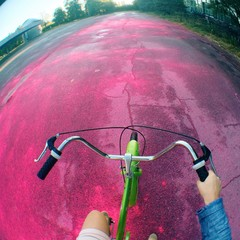Riding bicycle on the pink road