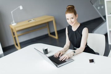 Young woman in the office