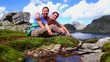 canvas print picture - Couple take a break during a trekking tour