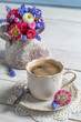 Daisy flowers and cup of coffee