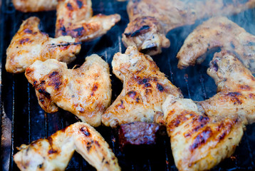 Closeup on chicken on grill