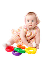 Child  girl  playing with educational toy color pyramidion