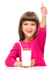 Cute little girl with a glass of milk