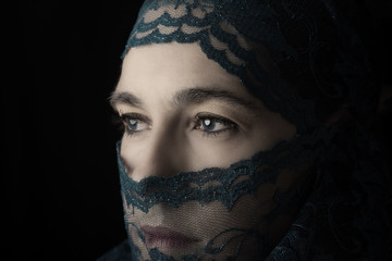 Middle Eastern woman portrait looking sad with green hijab artis