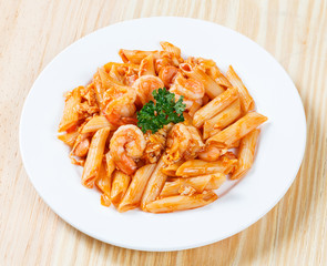 Stir fried macaroni and prawn with tomato sauce