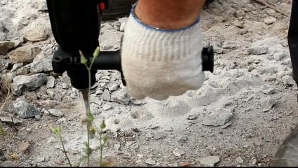 Drilling hole into concrete, closeup footage