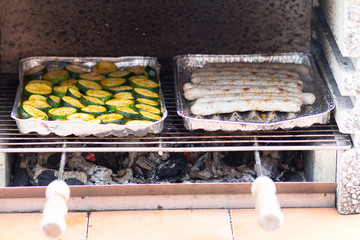 Grilled sausages and zucchini