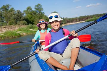 Kayaking on river.