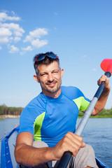 Young man kayaking