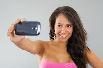 Black woman taking selfie