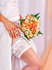 Garter at leg of bride.