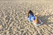 Woman on a sandy beach