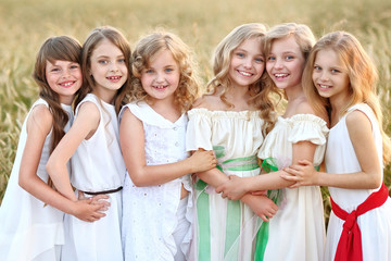 portrait of six little girls in cornfield field