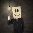 Businessman with smiley emoticon having idea 1