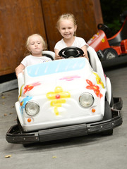 two little girls in a cart