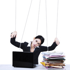 Businesswoman working like marionette
