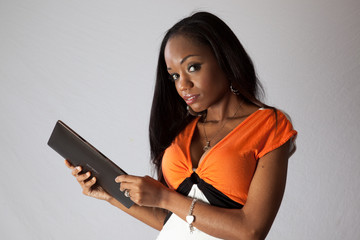 Black woman with computer tablet