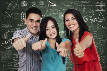 Group of students showing thumbs up 3