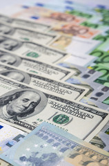 World Currency Concept: Closeup of European and the US Hard Curr