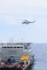 Helicopter landing on offshore oil rig