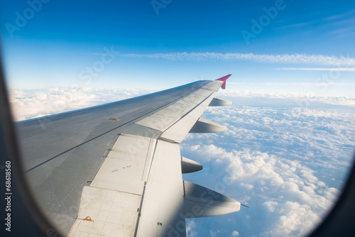 canvas print picture Airplane wing out of window